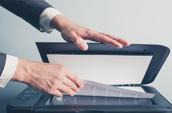 Requordit office man scanning