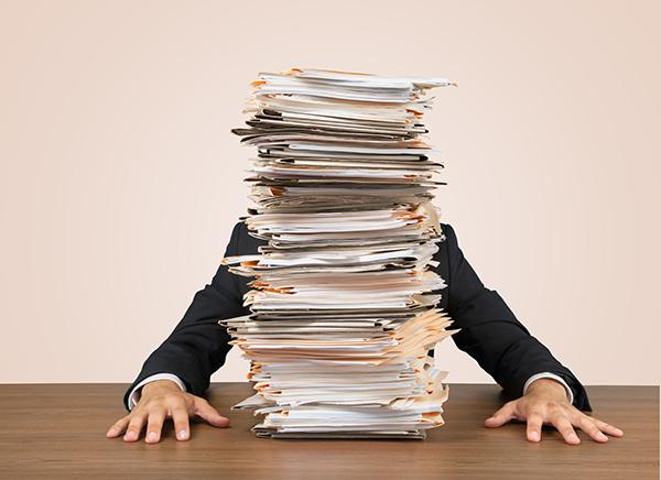Requordit Man Stacks Of Paper